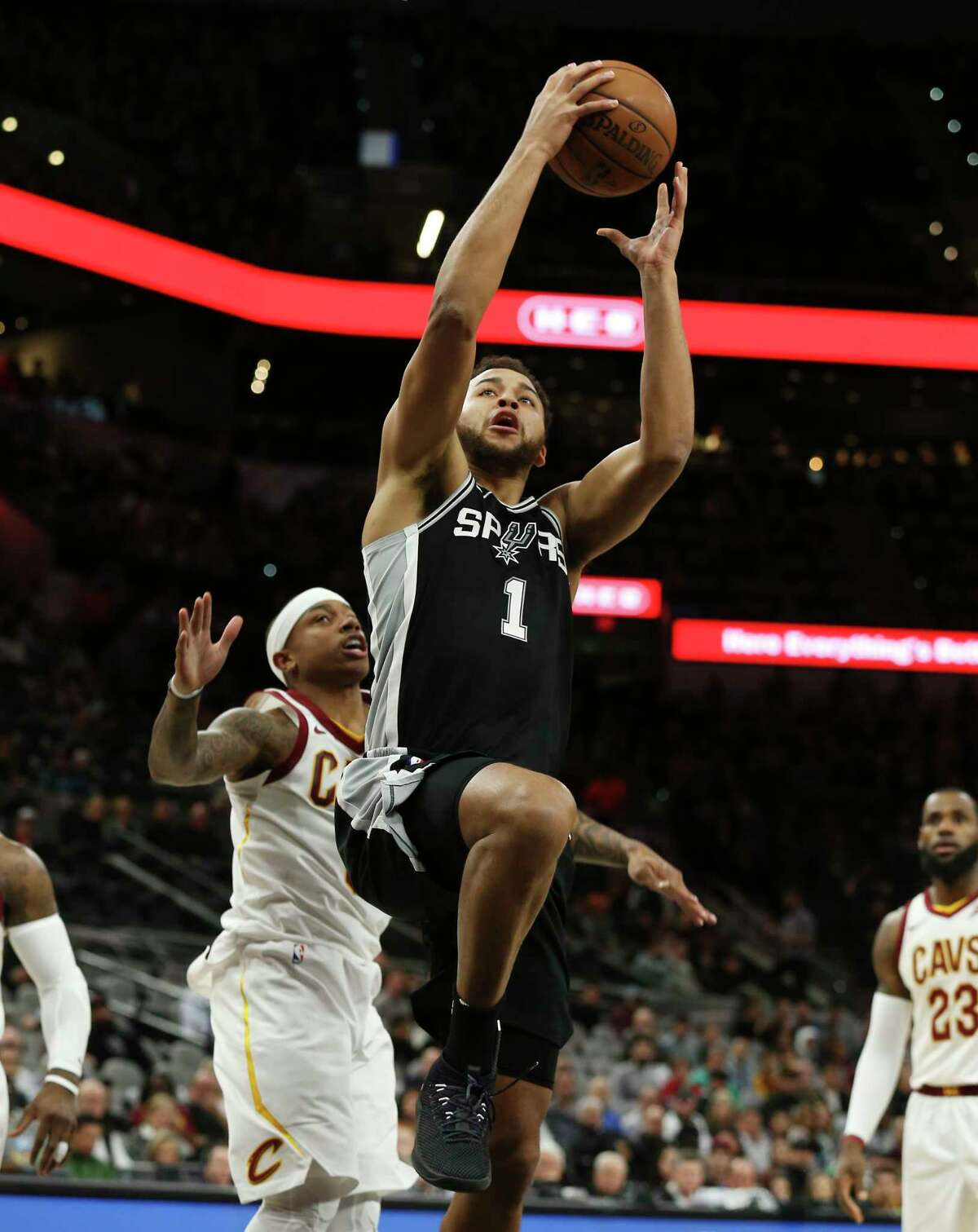 Spurs' Kyle Anderson (01) goes up for a score against Cleveland Cavaliers' Isaiah Thomas (03) at the AT&T Center on Tuesday, Jan. 23, 2018.