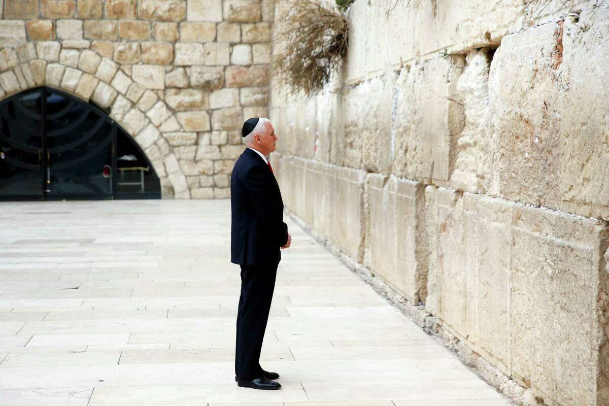 U.S. Vice President Mike Pence visits the Western Wall, Judaism's holiest prayer site, in Jerusalem's Old City, Tuesday, Jan. 23, 2018. (Ronen Zvulun/Pool photo via AP)