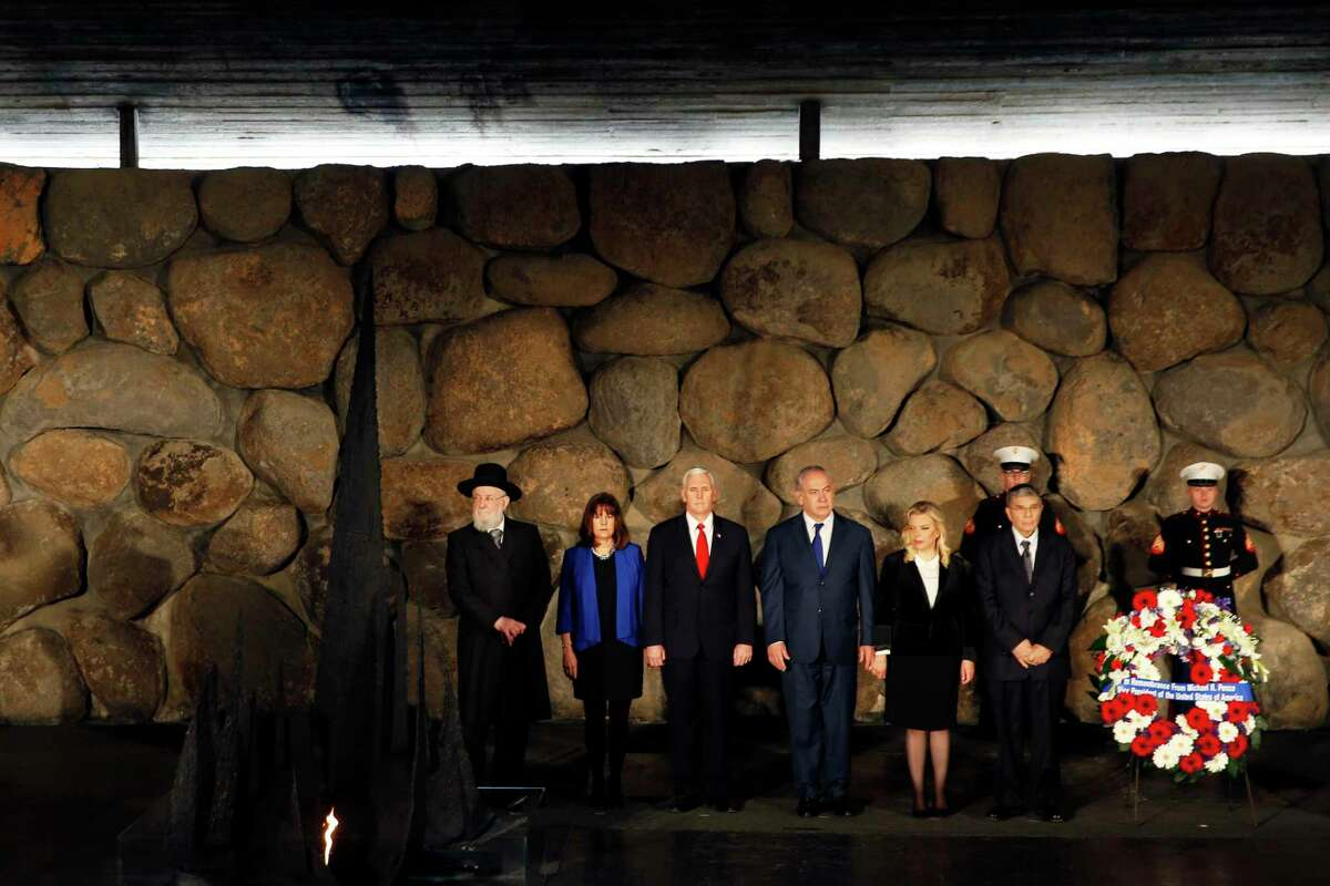 U.S. Vice President Mike Pence (3rd L), wife Karen (2nd L), Chairman of the Yad Vashem Council Rabbi Israel Meir Lau (L), Israeli Prime Minister Benjamin Netanyahu (3rd R), wife Sara Netanyahu (2nd R) and Chairman of Yad Vashem Avner Shalev (R) participate in a ceremony commemorating the six million Jews killed by the Nazis during the Holocaust, in the Hall of Remembrance at Yad Vashem World Holocaust Remembrance Center in Jerusalem, Tuesday, Jan. 23, 2018. (Roben Zvulin/Pool photo via AP)