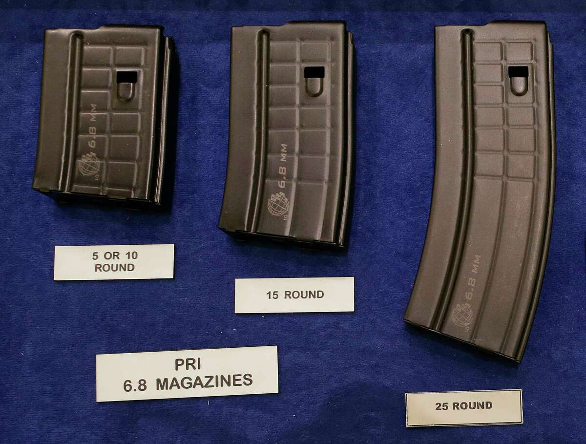 FILE - In this Jan. 16, 2013, file photo, high capacity magazines are seen on display at the 35th annual SHOT Show, Wednesday, Jan. 16, 2013, in Las Vegas. The largest gun industry trade show will be taking place in Las Vegas Jan. 23-26 just a few miles from where a gunman carried out the deadliest mass shooting in modern U.S. history. (AP Photo/Julie Jacobson, file)