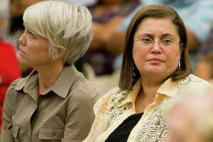 Jasmine Engineering CEO Jasmine Azima, right, sits next to Jasmine consultant Megan Augustine during a Harlandale school board special meeting in 2011. (Darren Abate/Special to the Express-News)