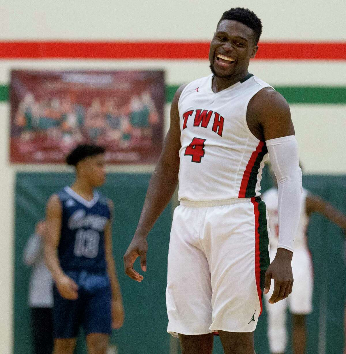 The Woodlands guard Romello Wilbert (4) reacts after drawing a foul late in the fourth quarter of a District 12-6A high school basketball game at The Woodlands High School, Tuesday, Jan. 23, 2018, in The Woodlands.