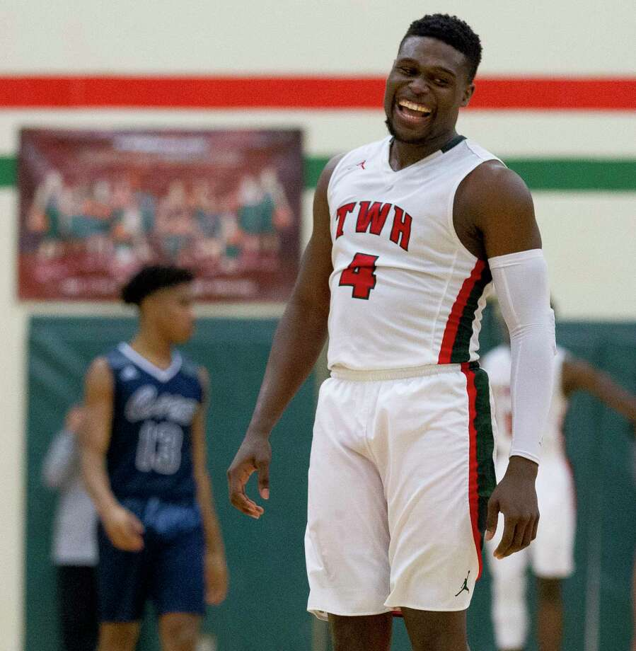 The Woodlands guard Romello Wilbert (4) reacts after drawing a foul late in the fourth quarter of a District 12-6A high school basketball game at The Woodlands High School, Tuesday, Jan. 23, 2018, in The Woodlands. Photo: Jason Fochtman, Houston Chronicle / © 2018 Houston Chronicle