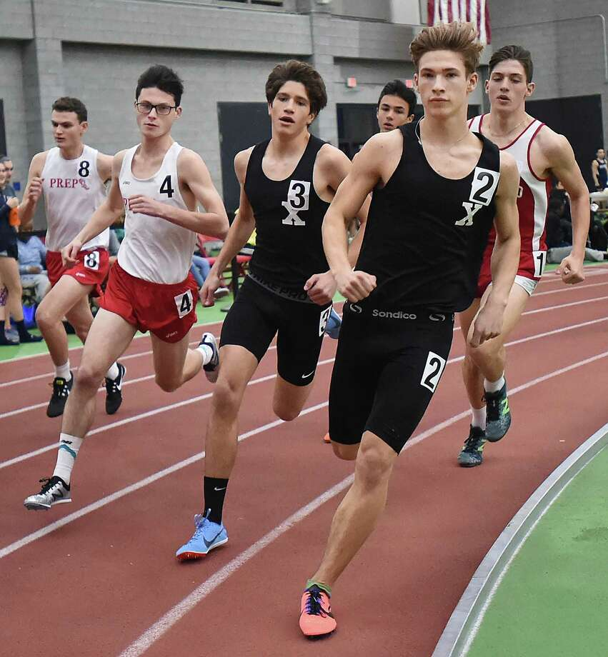 Xavier senior Owen Lally, wearing #2, placed first in the 1000 meter run in 2:39.45 at the SCC West Sectional indoor track and field meet, Tuesday, Jan. 23, 2018, at Floyd Little Athletic Center in New Haven. Placing second, Branford junior Marzio Mastroianni, wearing (#1) in 2:39.81and in third place, Fairfield Prep senior MacKinnon Sheldon finished in 2:40.91 wearing (#4). Xavier won the meet. Photo: Catherine Avalone / Hearst Connecticut Media / New Haven Register