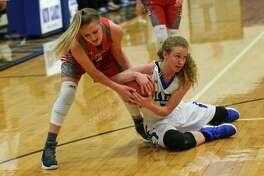 Splendora's Shayla Keck (3) and New Caney's Skylar Patton (3) battle for possession during the girls basketball game on Tuesday, Jan. 23, 2018, at New Caney High School. (Michael Minasi / Houston Chronicle)