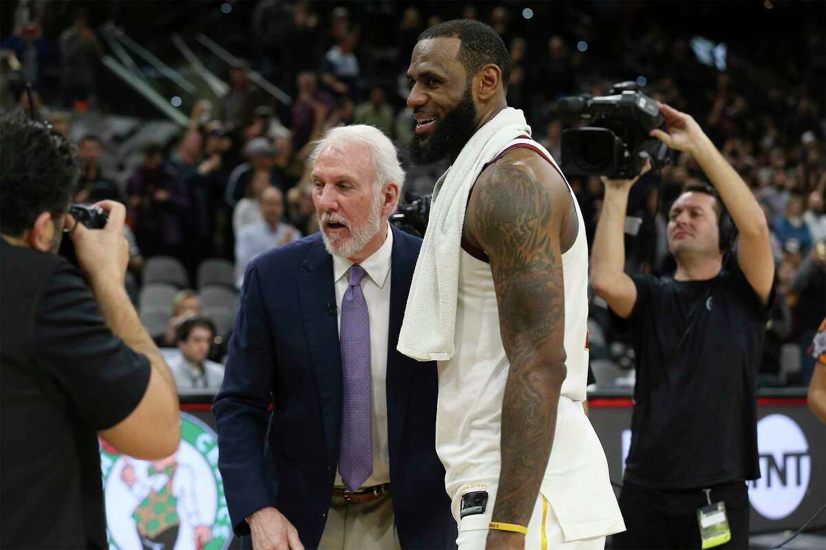 Spurs head coach Gregg Popovich offers his congratulations to Cleveland Cavaliers' LeBron James (23) at the AT&T Center on Tuesday, Jan. 23, 2018. James scored 28 points as he surpassed the 30,000 points mark in his NBA career. On Friday, June 29, 2018, James opted out of his contract with the Cavaliers, officially becoming a free agent.