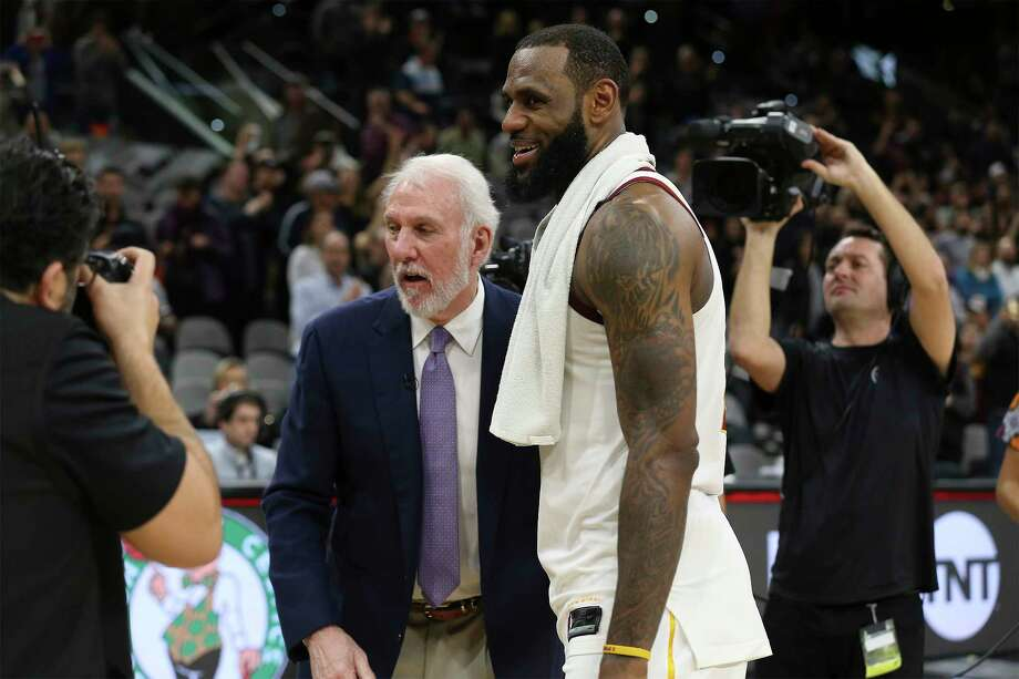 Spurs head coach Gregg Popovich offers his congratulations to Cleveland Cavaliers' LeBron James (23) at the AT&T Center on Tuesday, Jan. 23, 2018. James scored 28 points as he surpassed the 30,000 points mark in his NBA career. On Friday, June 29, 2018, James opted out of his contract with the Cavaliers, officially becoming a free agent. Photo: Kin Man Hui, San Antonio Express-News / ©2018 San Antonio Express-News