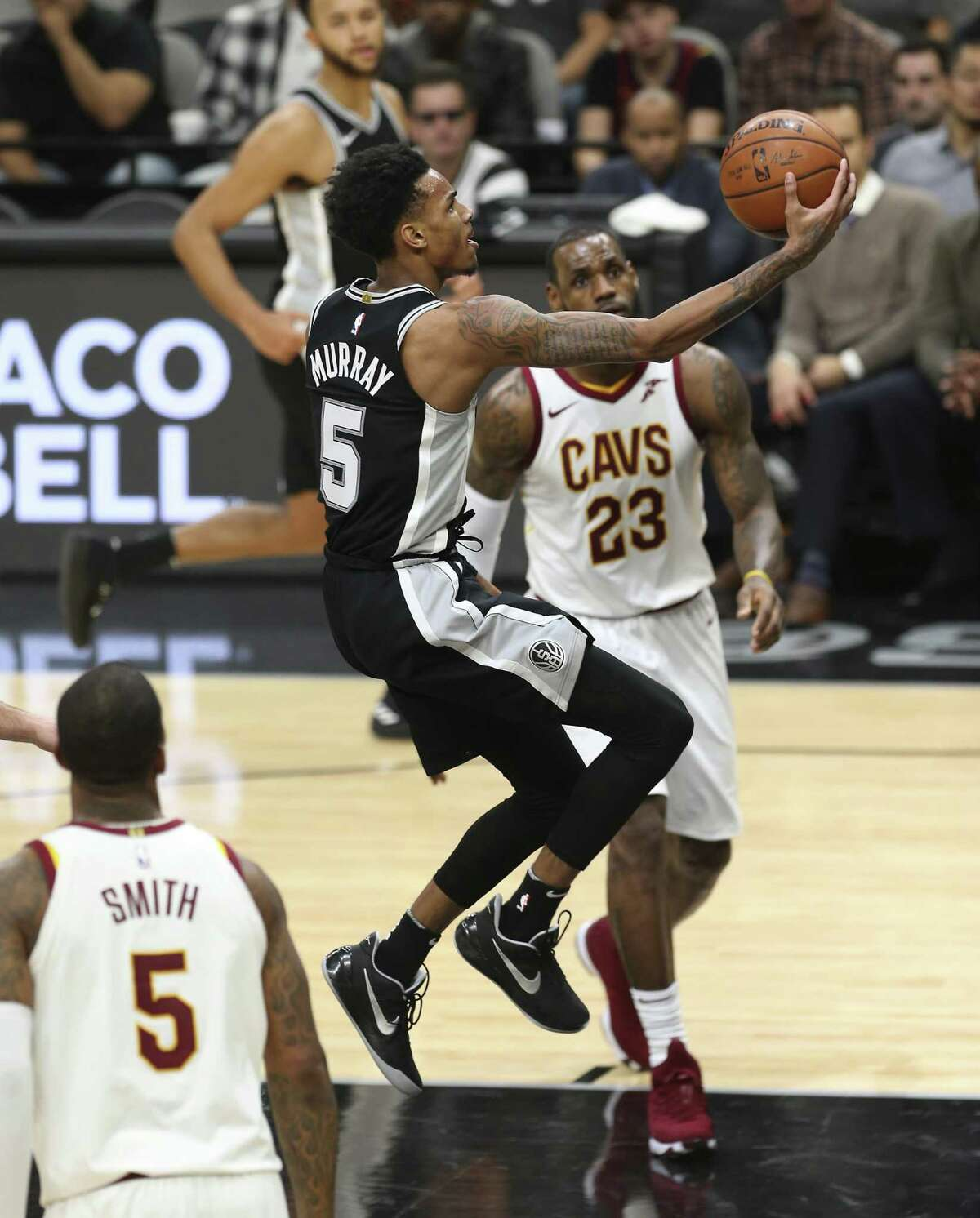 Spurs' Dejounte Murray (05) gets a layup against the Cleveland Cavaliers at the AT&T Center on Tuesday, Jan. 23, 2018. (Kin Man Hui/San Antonio Express-News)