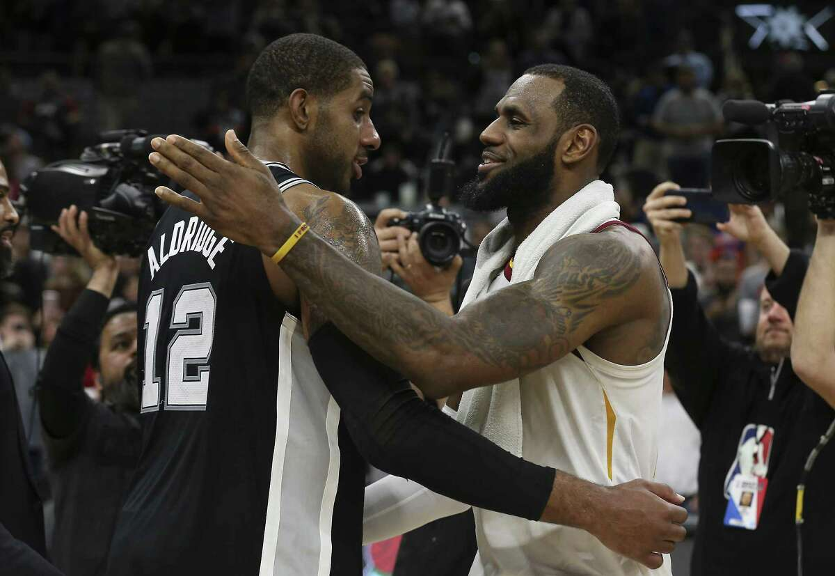 Spurs' LaMarcus Aldridge (12) congratulates Cleveland Cavaliers' LeBron James (23) after the game at the AT&T Center on Tuesday, Jan. 23, 2018. James scored 28 points as he surpassed the 30,000 points scored in his NBA career. Spurs defeated the Cavs, 114-102. (Kin Man Hui/San Antonio Express-News)