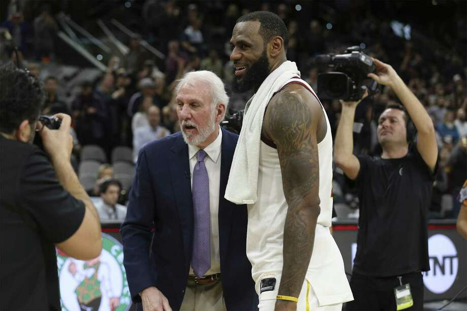 Spurs head coach Gregg Popovich overs his congratulations to Cleveland Cavaliers' LeBron James (23) at the AT&T Center on Tuesday, Jan. 23, 2018. James scored 28 points as he surpassed the 30,000 points mark in his NBA career. Spurs defeated the Cavs, 114-102. (Kin Man Hui/San Antonio Express-News) Photo: Kin Man Hui,  Staff / San Antonio Express-News / ©2018 San Antonio Express-News