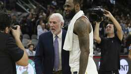 Spurs head coach Gregg Popovich overs his congratulations to Cleveland Cavaliers' LeBron James (23) at the AT&T Center on Tuesday, Jan. 23, 2018. James scored 28 points as he surpassed the 30,000 points mark in his NBA career. Spurs defeated the Cavs, 114-102. (Kin Man Hui/San Antonio Express-News)