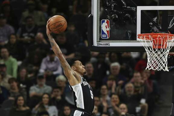 Spurs' Dejounte Murray (05) rears back for dunk against Cleveland Cavaliers' Derrick Rose (01) at the AT&T Center on Tuesday, Jan. 23, 2018. Spurs defeated the Cavs, 114-102. (Kin Man Hui/San Antonio Express-News)
