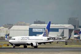 FILE - In this Sept. 9, 2015, file photo, a United Airlines jet lands at Newark Liberty International Airport in Newark, N.J. United Continental Holdings, Inc. reports earnings, Tuesday, Jan. 23, 2018. (AP Photo/Mel Evans, file)
