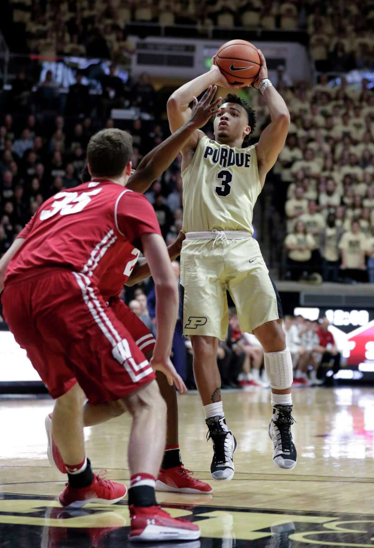 Purdue guard Carsen Edwards (3) shoots over Wisconsin forward Nate Reuvers (35) in the second half of an NCAA college basketball game in West Lafayette, Ind., Tuesday, Jan. 16, 2018. Purdue defeated Wisconsin 78-50. (AP Photo/Michael Conroy)