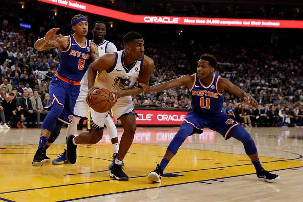 Kevon Looney (5) clears a rebound in the first half as the Golden State Warriors played the New York Knicks at Oracle Arena in Oakland, Calif., on Tuesday, January 23, 2018.