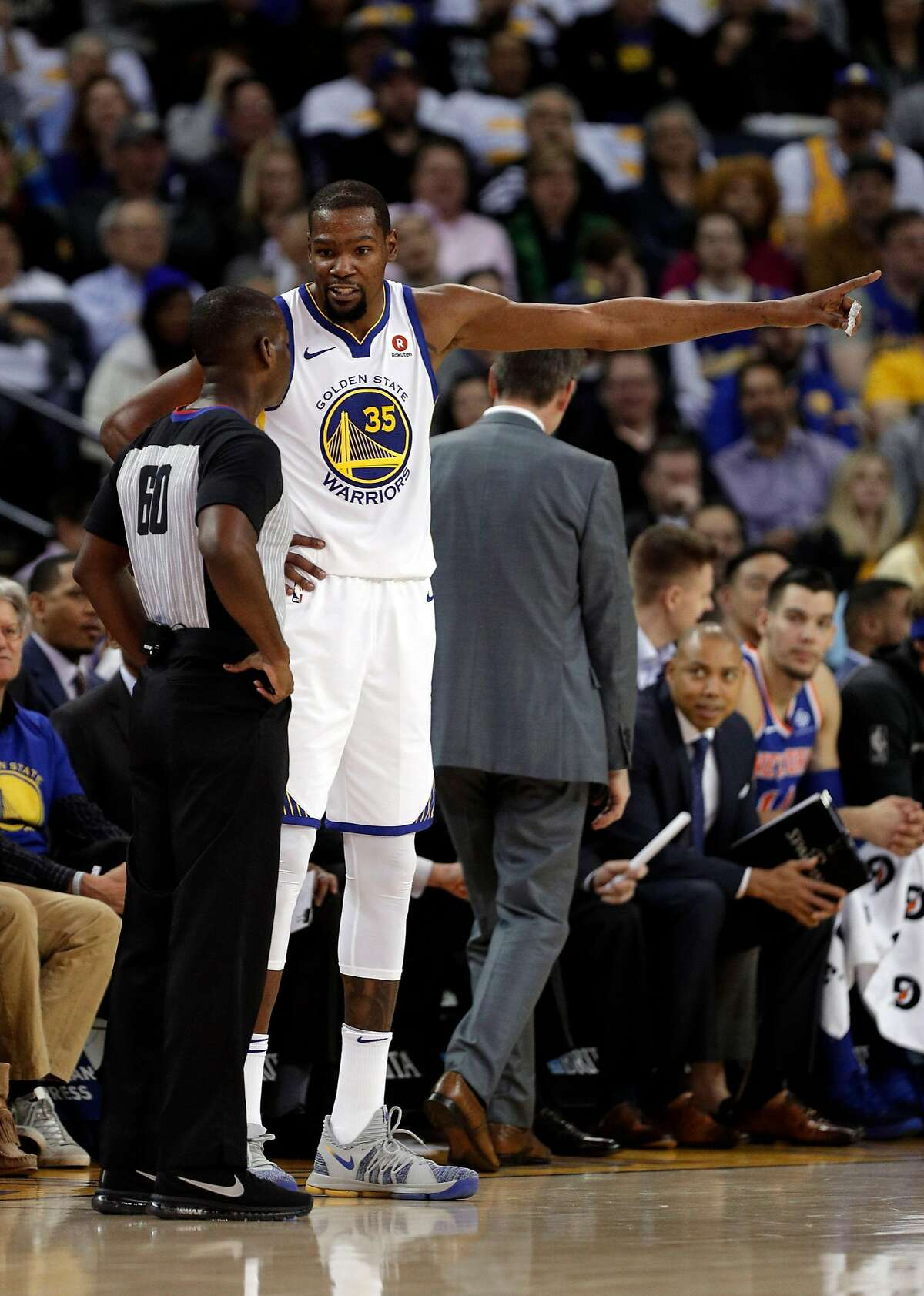 Kevin Durant (35) talks with referee James Williams (60) after he was called for a foul in the first half as the Golden State Warriors played the New York Knicks at Oracle Arena in Oakland, Calif., on Tuesday, January 23, 2018.