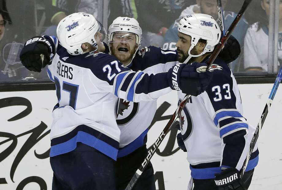 The Winnipeg Jets' Bryan Little (center) celebrates his overtime goal with teammates Nikolaj Ehlers (left) and Dustin Byfuglien at SAP Center. Photo: Marcio Jose Sanchez, Associated Press