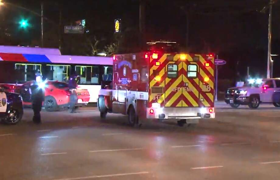 Two people were taken to the hospital after a motorist ran a red light and slammed his Dodge Challenger into the side of a Metro bus in west Houston late Monday, Houston Police said. The male driver was heading eastbound on Westheimer Road near Post Oak Boulevard around 11 p.m. when he hit the bus, police told a reporter at the scene. Photo: Metro Video LLC / For The Houston Chronicle