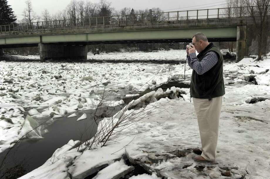 Arnold Wallace, of Wolcott, drove to Kent Monday to see the ice jams on the Housatonic River. He stops to take a photo near a bridge that crosses the Housatonic. Photo: Carol Kaliff / Hearst Connecticut Media / The News-Times