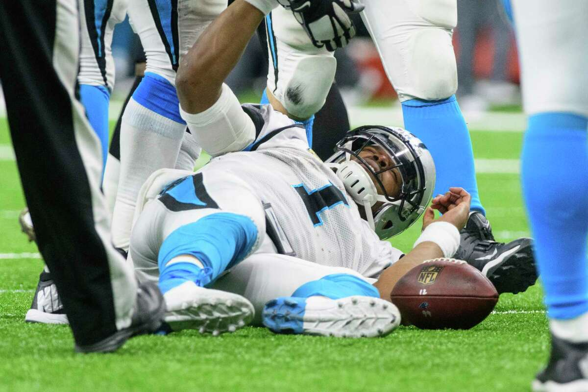 Carolina Panthers quarterback Cam Newton lies on the field after being sacked during an NFL NFC wild-card playoff football game against the New Orleans Saints on Sunday, Jan. 7, 2018 in New Orleans. New Orleans won 31-26. (Scott Clause/The Daily Advertiser via AP)