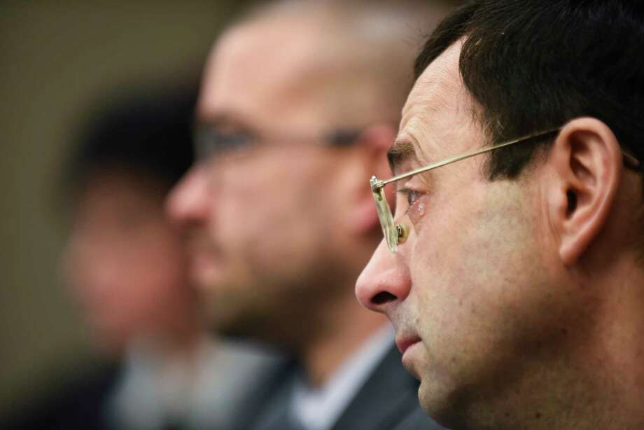 A tear falls from Larry Nassar's eye Friday, Jan. 19, 2018, as he is confronted  in Circuit Judge Rosemarie Aquilina's courtroom during the fourth day of victim impact statements regarding former sports medicine doctor Larry Nassar, who pled guilty to seven counts of sexual assault in Ingham County, and three in Eaton County. (Matthew Dae Smith /Lansing State Journal via AP) Photo: Matthew Dae Smith, Associated Press / Lansing State Journal