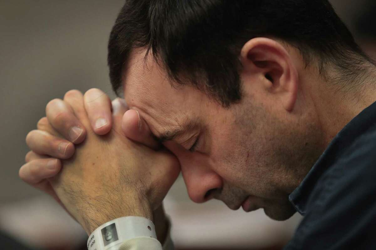 LANSING, MI - JANUARY 16: Larry Nassar listens to victim impact statements prior to being sentenced after being accused of molesting about 100 girls while he was a physician for USA Gymnastics and Michigan State University, where he had his sports-medicine practice on January 16, 2018 in Lansing, Michigan. Nassar has pleaded guilty in Ingham County, Michigan, to sexually assaulting seven girls, but the judge is allowing all his accusers to speak. Nassar is currently serving a 60-year sentence in federal prison for possession of child pornography.