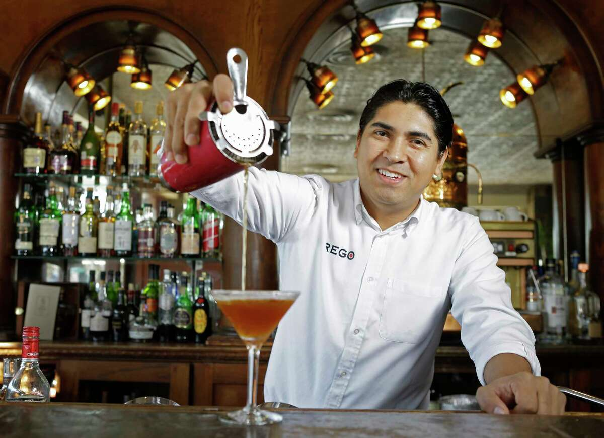 Marvin Gomez pours a Manhattan with Woodford Reserve at Prego, 2520 Amherst, Monday, Jan. 22, 2018, in Houston. ( Melissa Phillip / Houston Chronicle )