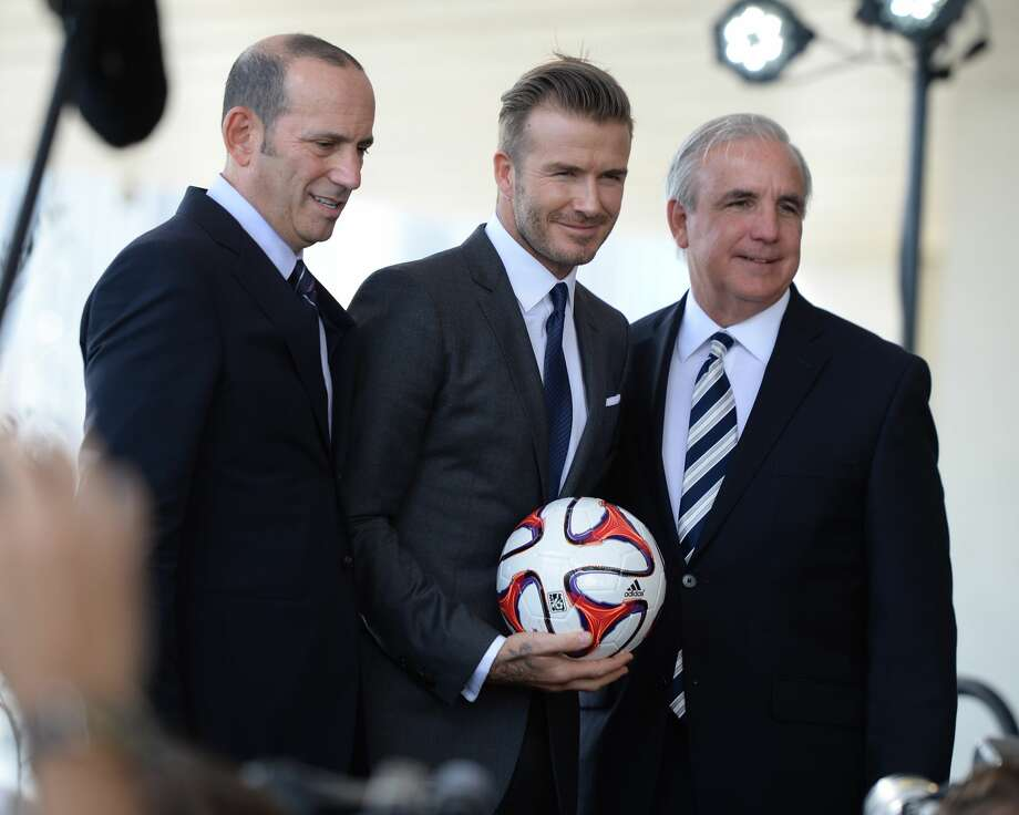 MIAMI, FL - FEBRUARY 05: Commissioner Don Garber, David Beckham and Mayor Carlos Gimenez attends  press conference to announce plans for Major League Soccer at PAMM Art Museum on February 5, 2014 in Miami, Florida. (Photo by Uri Schanker/WireImage) Photo: Uri Schanker/WireImage