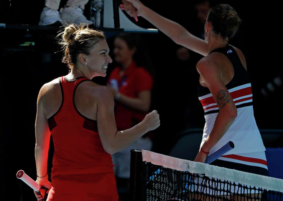 Romania's Simona Halep, left, celebrates after defeating Karolina Pliskova,right, of the Czech Republic in their quarterfinal at the Australian Open tennis championships in Melbourne, Australia, Wednesday, Jan. 24, 2018. (AP Photo/Ng Han Guan)