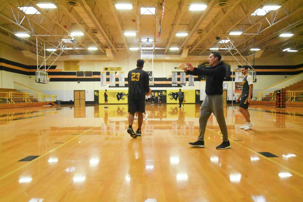 Kolby Huseman reviews plays with Aidan Hemphill and Josh Gusman. Klein Oak finished 19-12, its first winning season since 1995, under Kolby Huseman's first year as head coach, accumulating more wins than the previous three seasons combined.