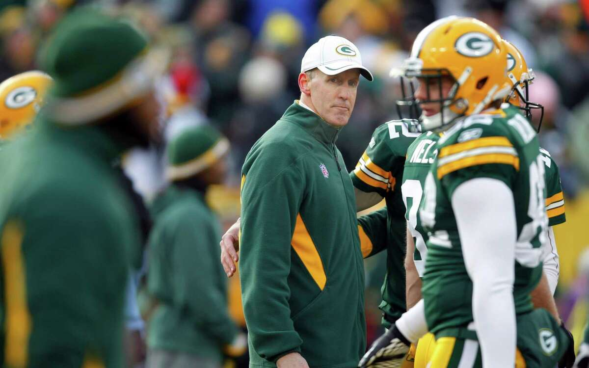 In this Jan, 15, 2012, file photo, Green Bay Packers offensive coordinator Joe Philbin, center, walks on the field before an NFL divisional playoff football game against the New York Giants in Green Bay, Wis. A person familiar with the decision says Philbin has accepted an offer to become the Miami Dolphins' head coach. The person confirmed the deal to The Associated Press on condition of anonymity Friday, Jan. 20, 2012, because the team hadn't made an announcement.