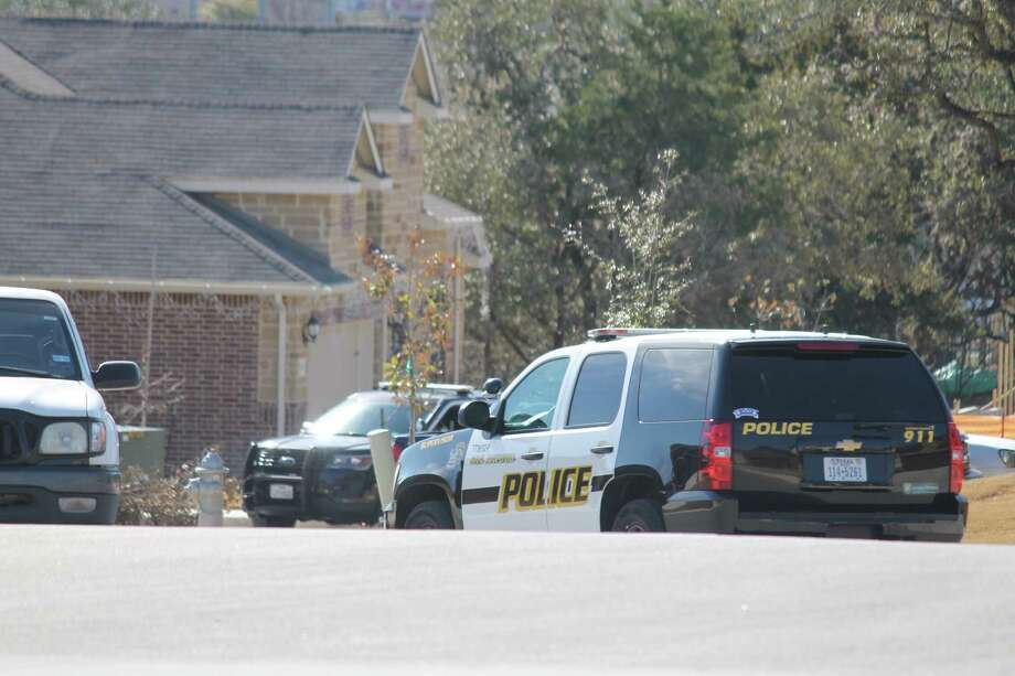 Several police units are outside a home in the 7000 block of Ravensdale after a disturbance call on Jan. 24, 2018 Photo: Fares Sabawi/San Antonio Express-News