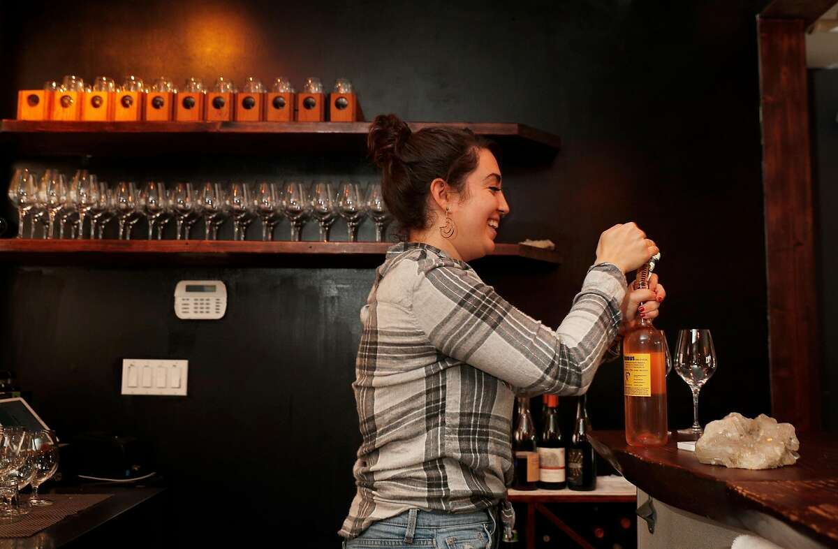 Allee Cakmis works the bar pouring drinks and making small plates at the Fig and Thistle Wine Bar in San Francisco, Calif., on Sunday, January 21, 2018.