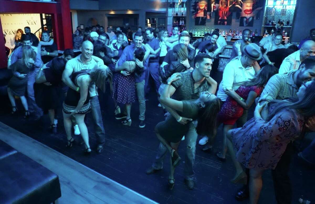 Rooftop Party! Salsa & Bachata Social Mixer at Atlas Pub Friday.