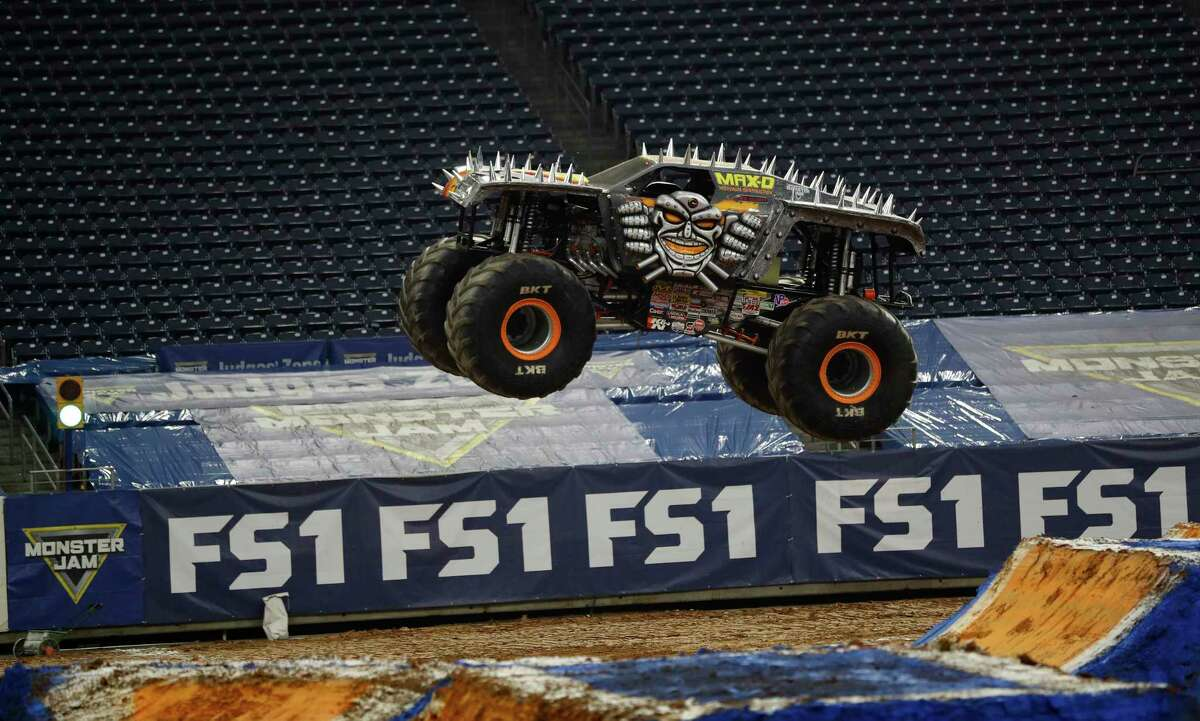Monster truck Maz-D driven by Neil Elliott leaps into the air during a practice run for the Monster Jam FS1 Championship Series at NRG Stadium, Friday, February 10, 2017. This year's Monster Jam events are Saturday.