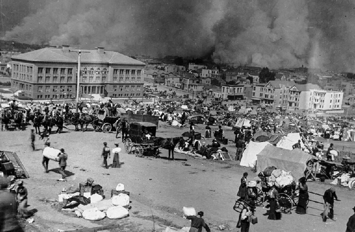 April 18, 1906: Dolores Park -- then known as Mission Park -- is full of refugees on the day of the earthquake as the city burns in the background.
