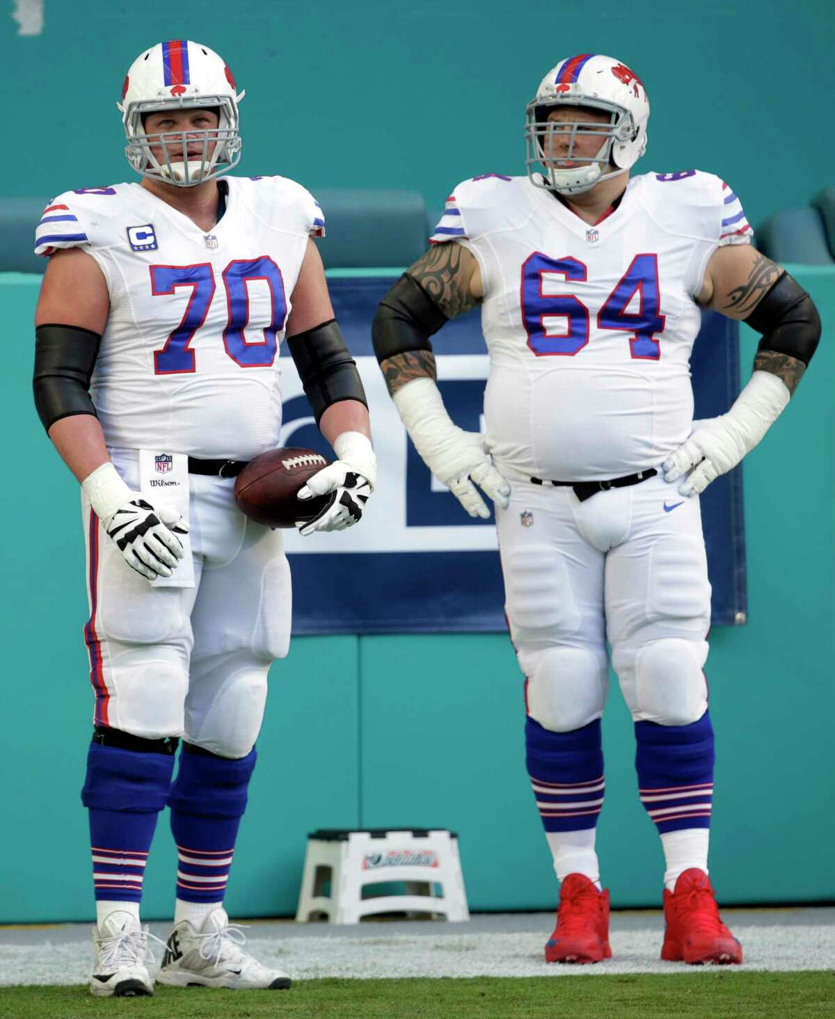 Buffalo Bills center Eric Wood (70) and offensive guard Richie Incognito (64), warm up before during the first half of an NFL football game against the Miami Dolphins, Sunday, Dec. 31, 2017, in Miami Gardens, Fla. (AP Photo/Lynne Sladky)