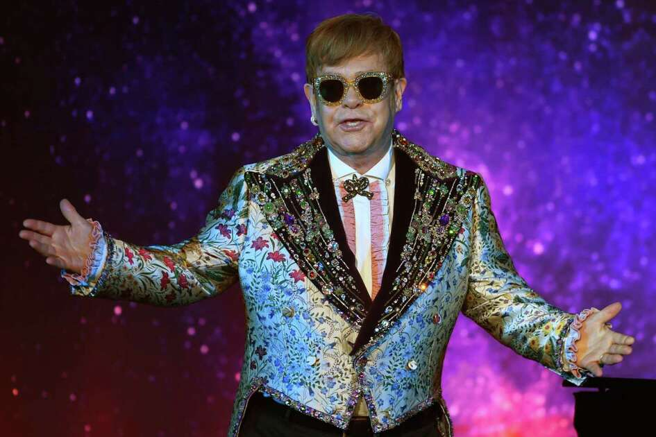 "Sir Elton John has a performance of two songs before holding a press conference in New York January 24, 2018. Pop legend Elton John on Wednesday announced a final tour, saying he intends to stop traveling to spend more time with his family. The 70-year-old British entertainer, revealing his plans at a gala New York event, said he planned to ""go out with a bang"" with a global tour that may last several years. / AFP PHOTO / TIMOTHY A. CLARYTIMOTHY A. CLARY/AFP/Getty Images"