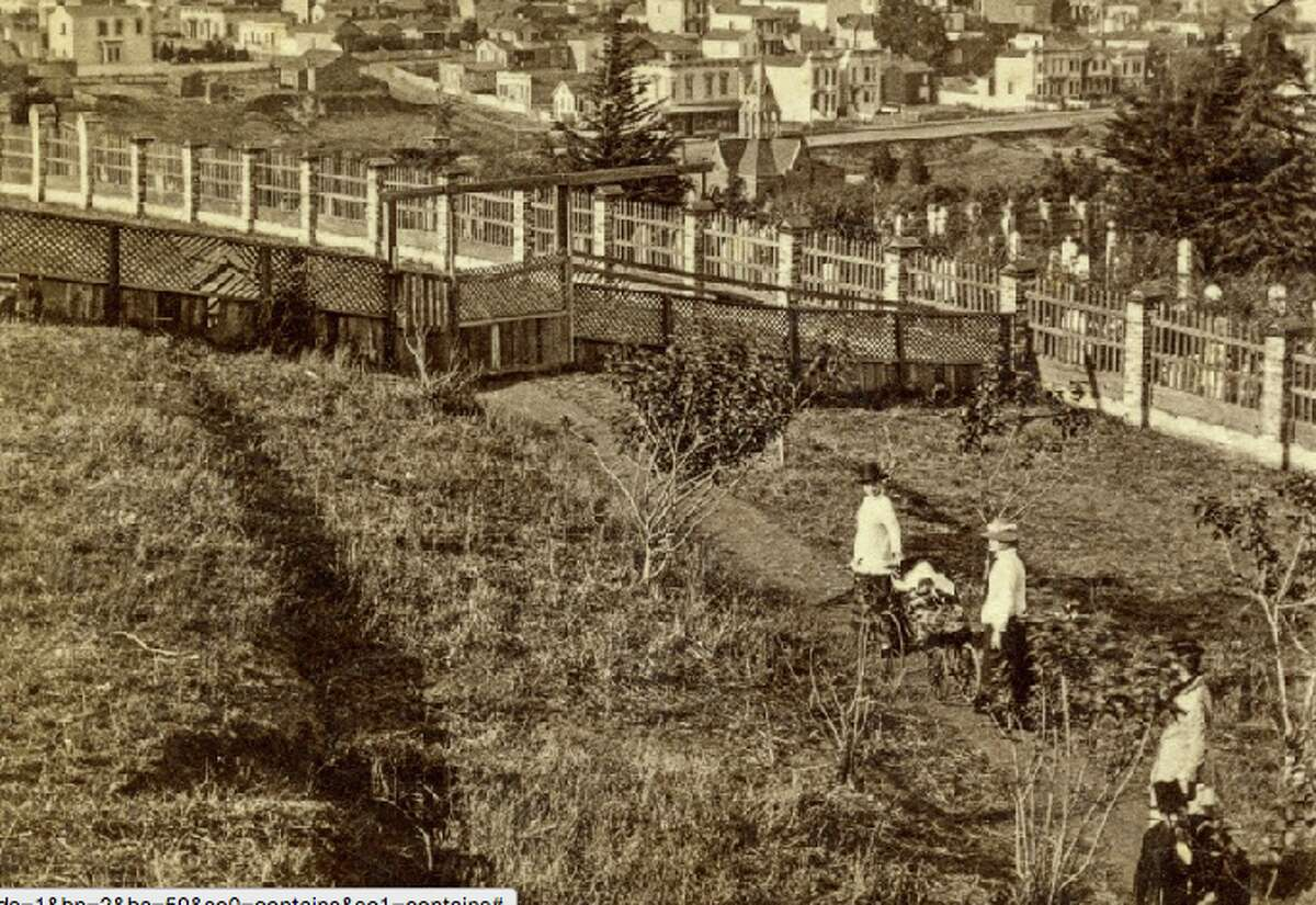 Circa 1885: People standing on the hill of the old Jewish cemetery, the location of what is now Dolores Park.