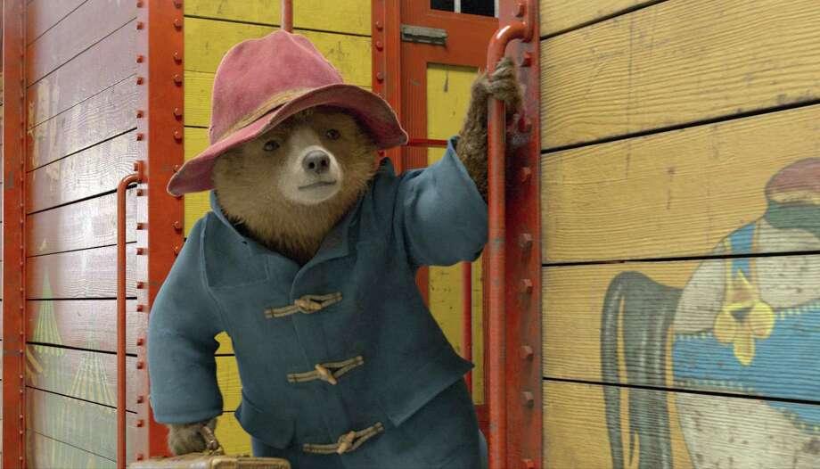 "Paddington, voiced by Ben Whishaw, in a scene from ""Paddington 2."" Photo: Warner Bros. Via AP / ©P&Co Ltd. / SC 2017"