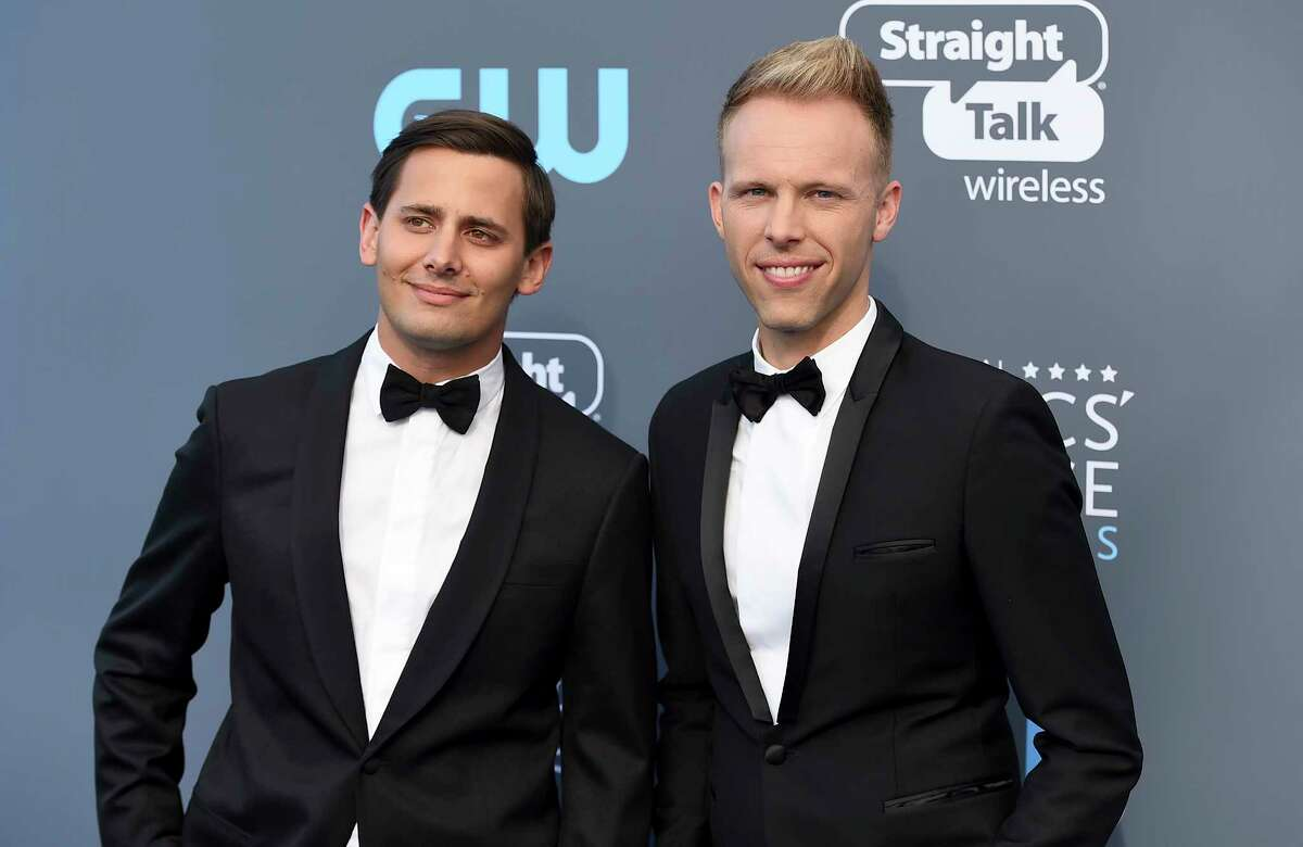 FILE - In this Jan. 11, 2018 file photo, Benj Pasek, left, and Justin Paul arrive at the 23rd annual Critics' Choice Awards in Santa Monica, Calif. The pair were nominated for an Oscar for best original song for