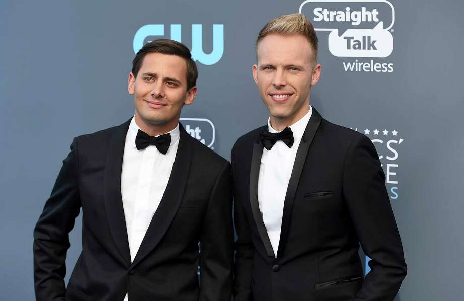 """FILE - In this Jan. 11, 2018 file photo, Benj Pasek, left, and Justin Paul arrive at the 23rd annual Critics' Choice Awards in Santa Monica, Calif. The pair were nominated for an Oscar for best original song for """"This Is Me,"""" from the film """"The Greatest Showman."""" (Photo by Jordan Strauss/Invision/AP, File) Photo: Jordan Strauss / 2018 Invision"""