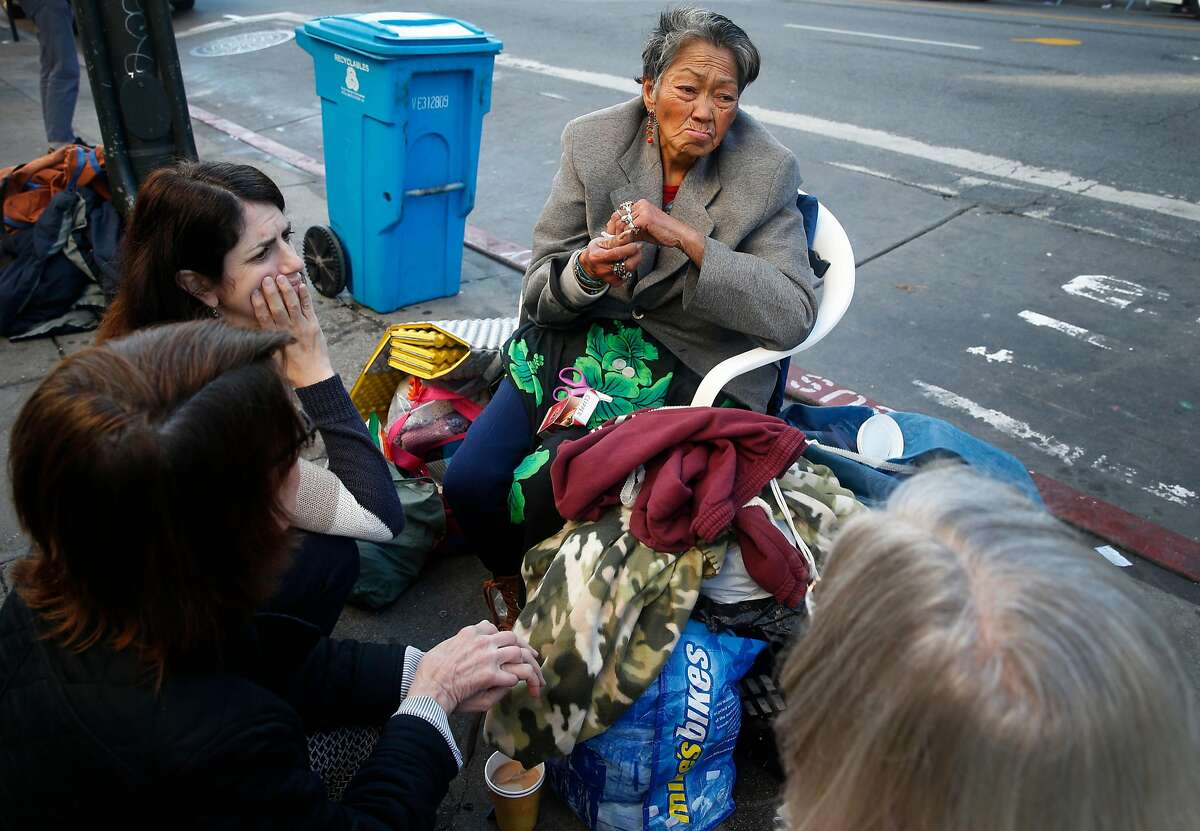 Alice, a homeless woman who spends her days and nights in front of the Burger King at 16th and Mission streets, is visited by Supervisor Hillary Ronen, Anne Gallagher and Rory Ryan in San Francisco, Calif. on Wednesday, Nov. 29, 2017.