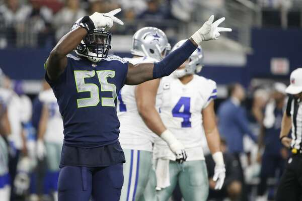 Seattle Seahawks defensive end Frank Clark (55) motions toward a penalty against the Dallas Cowboys during an NFL football game, Sunday, Dec. 24, 2017, in Arlington, Texas. (AP Photo/Michael Ainsworth)