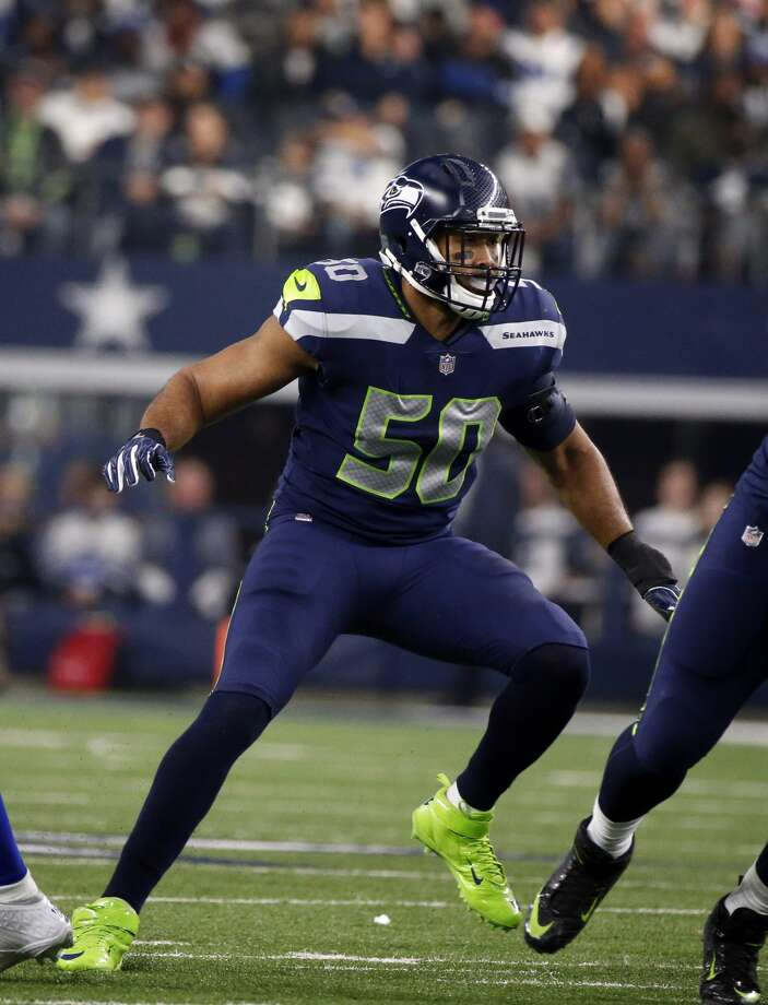 K.J. Wright spoke to local media Thursday for the first time since returning to practice this week. Photo: Michael Ainsworth/AP