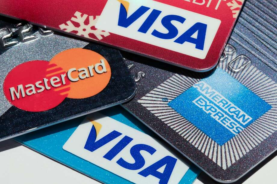 Americans are defaulting on their credit cards at the highest rate in nearly a year. Experts blame the improving economy. (Dreamstime/TNS) Photo: Dreamstime, TNS