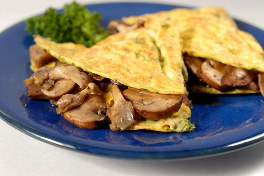 This herbed omelet can be made with chanterelles or an exotic mushroom mix. (Photo by Will Waldron / Food Styling by Ruth Fantasia / Times Union) / 00006215A