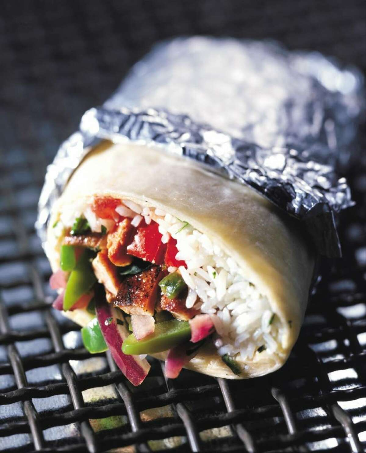 Chipotle's commitment to using organic, locally sourced ingredients can be seen in its tacos, burritos and salads. (Chipotle Mexican Grill)
