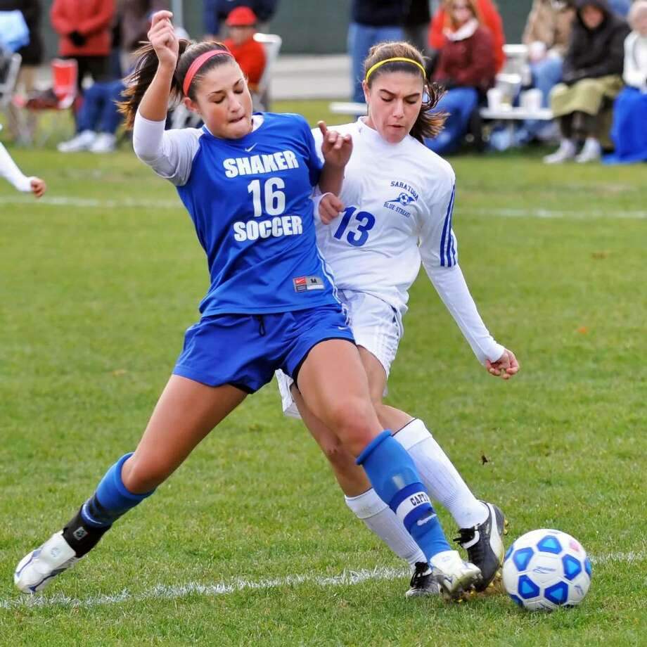 Shaker High's #16, Krista Pilla, left, and Saratoga Springs #13, Briana Sirianni during the girls' soccer Class AA quarterfinal at Saratoga Springs High School on  Wednesday, November 4, 2009.   (John Carl D'Annibale / Times Union) Photo: John Carl D'Annibale / 00006239A