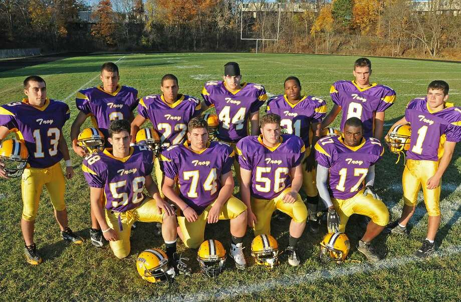 The starting defense for Troy High School football team: From back row (l.to r.) Sean McDermott, Jerrod Heiser, Elijah Gamble, Kyle Geraci, Stephaun Grinage, Ian Blair and Grady Byrnes. Front row (l. to r.) Vinney Pennisi, Mike Leisenfelder, David Jabour and Dorrel Williams. (Lori Van Buren / Times Union) Photo: LORI VAN BUREN/TIMES UNION